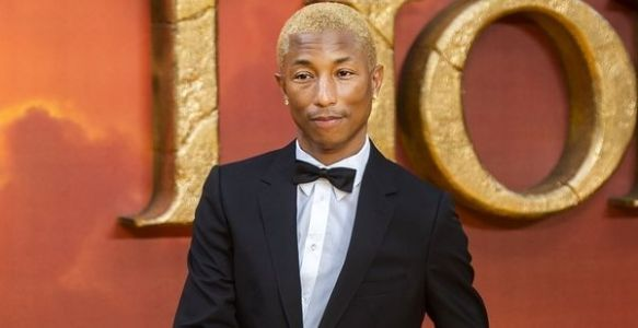 PHOTOS. Quand le prince Harry applaudit le look particulier de Pharrell Williams à l'avant-première du Roi Lion