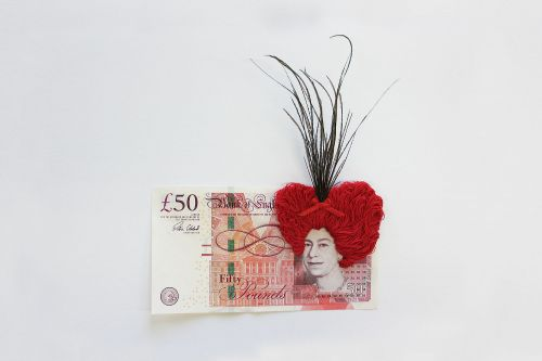 Embroidering Hair Onto Dollars and British Pounds